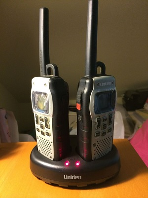 Uniden GMR5089 submersible walkie talkie on charging stand